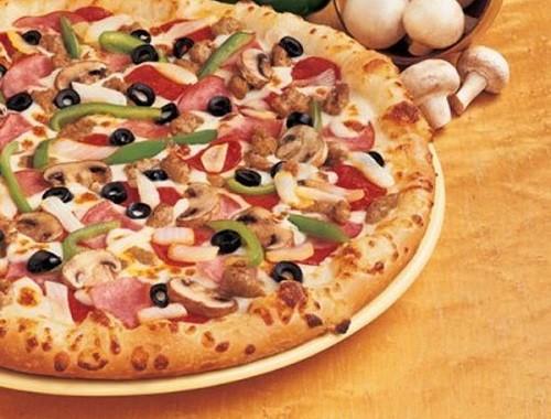 طريقة عمل عجينة بيتزا دومينوز